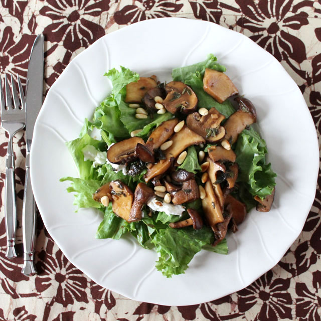 salad with mushrooms goat cheese and pinenuts served warm