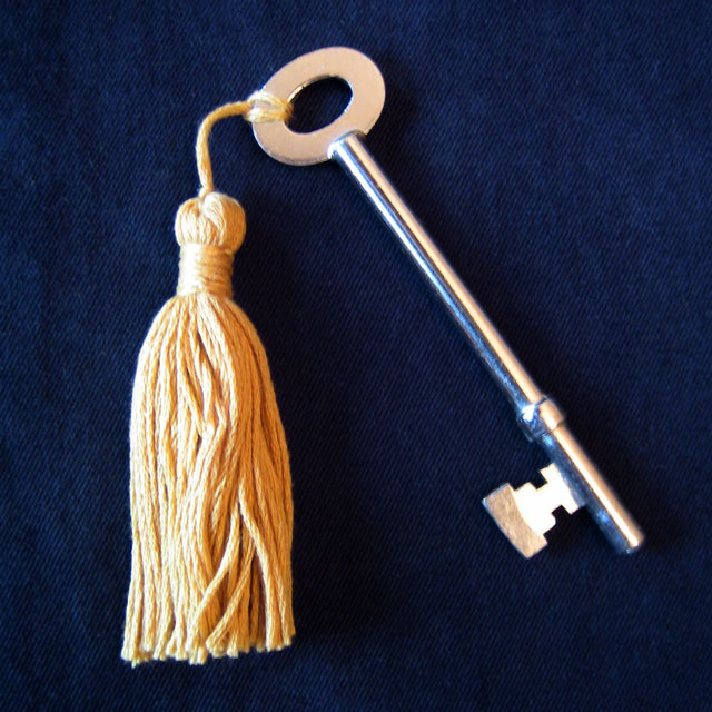 handmade tassel made with embroidery floss on vintage key graduation party favour decoration