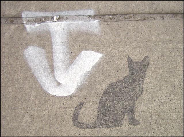 cat stencil on sidewalk