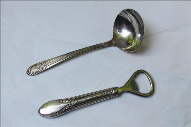 silver sauce ladle and bott