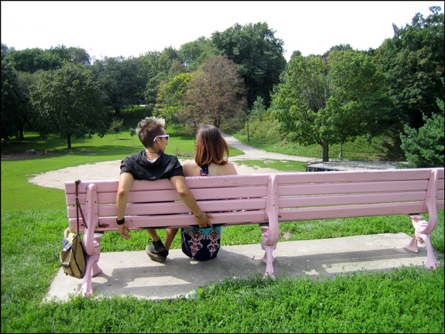 two people on a bench