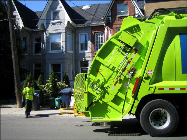 green garbage truck