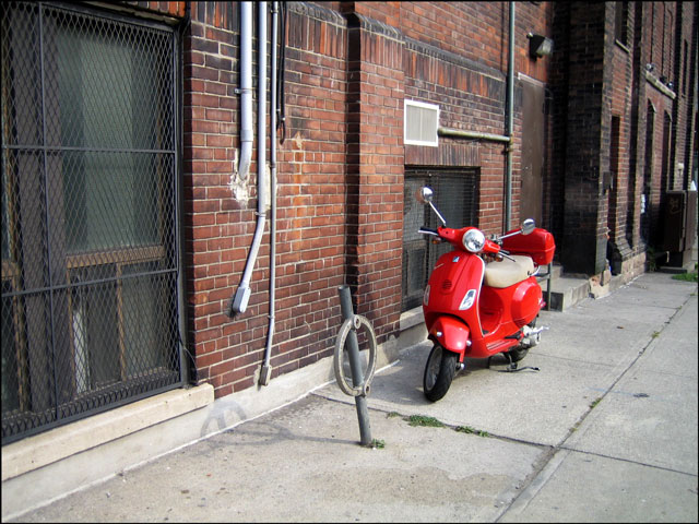 red scooter old wall