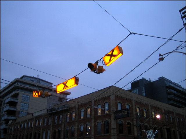crosswalk sign at dusk