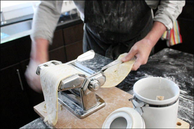 passing-dough-through-imperia-pasta-machine