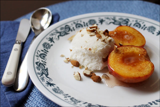 baked-peaches-dessert with honey cinnamon and almonds