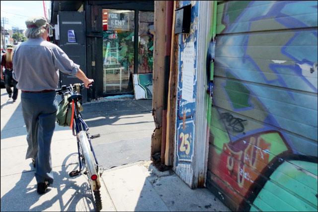 man-pushing-bike-kensington