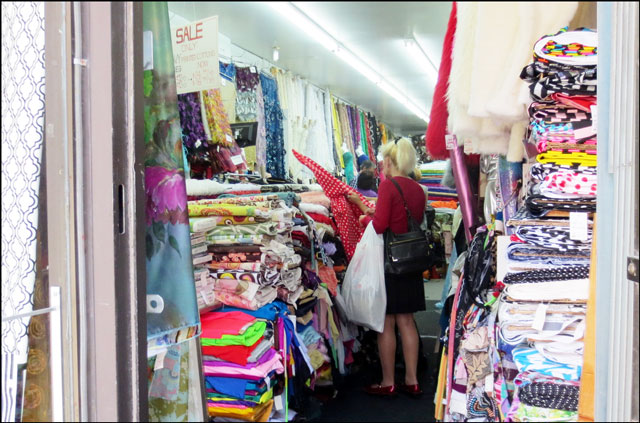 peeking into a shop on quee