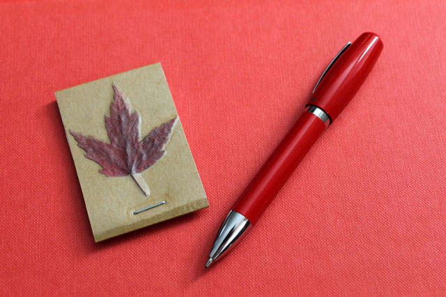 handmade notepad with pressed leaf