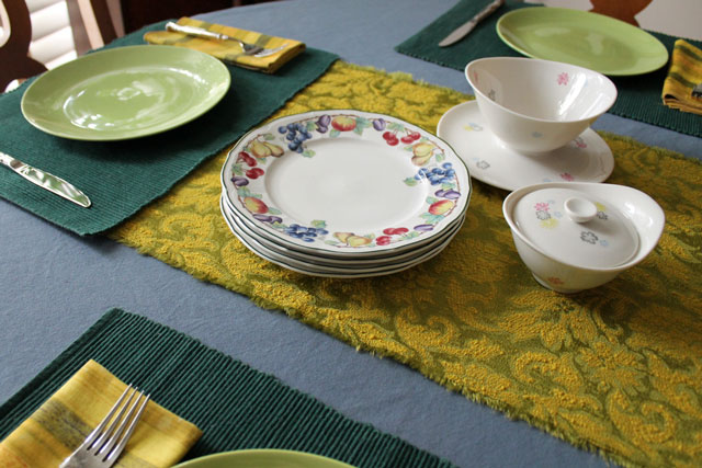 table set with green gold and blue