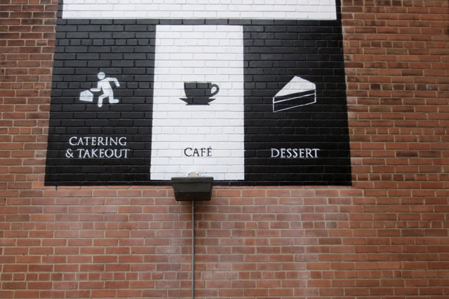 black-and-white-sign-on-brick