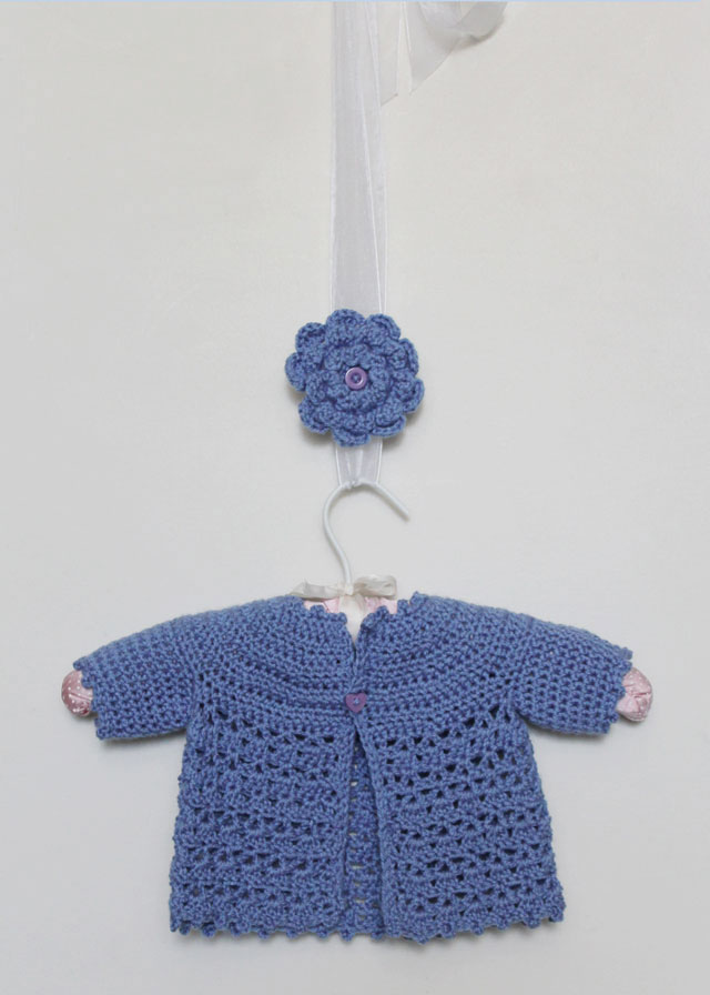 crocheted baby cardigan and matching brooch for mom loulou downtown