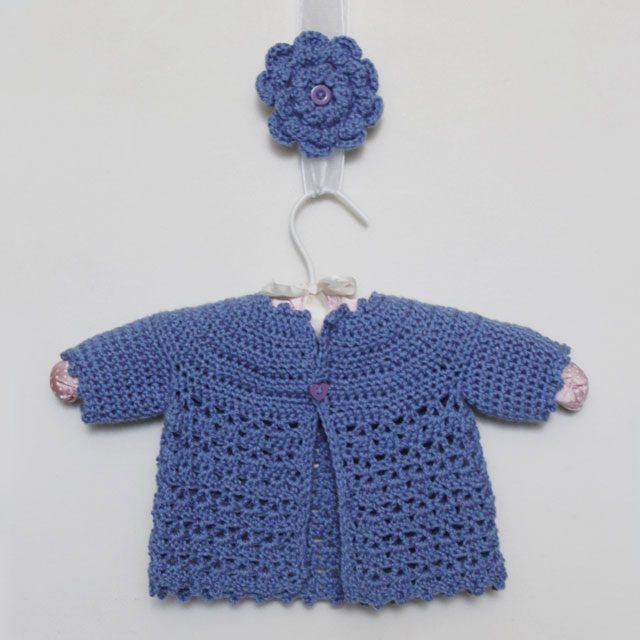 crocheted baby jacket and matching flower brooch made with free patterns