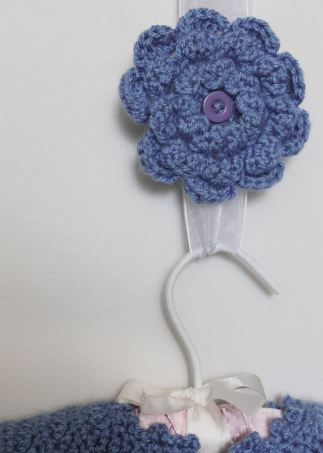 crocheted baby sweater and brooch for mom