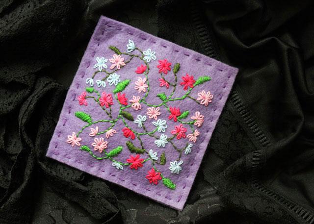 hand embroidery on felt making a lavender sachet