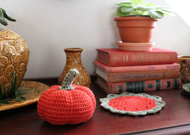 crocheted pumpkin and small doily