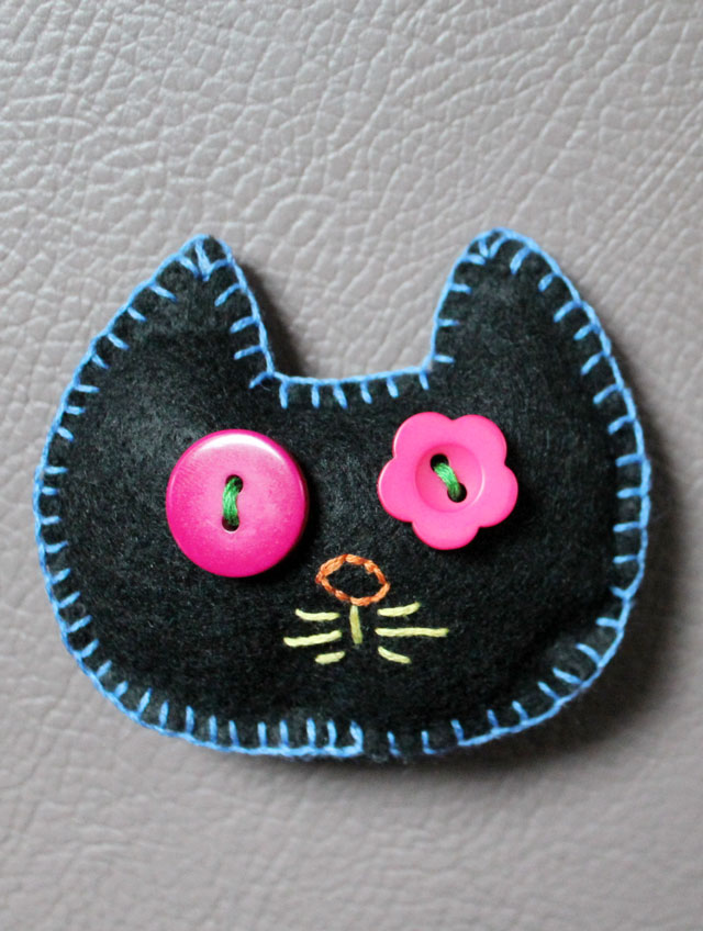 felt embroidery and buttons cat head could be brooch