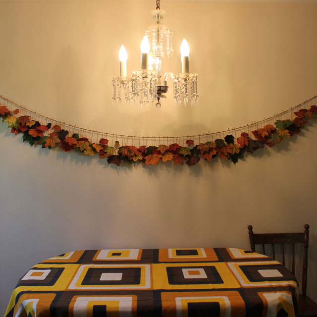 handmade garland with colored fall maple leaves and twine diy
