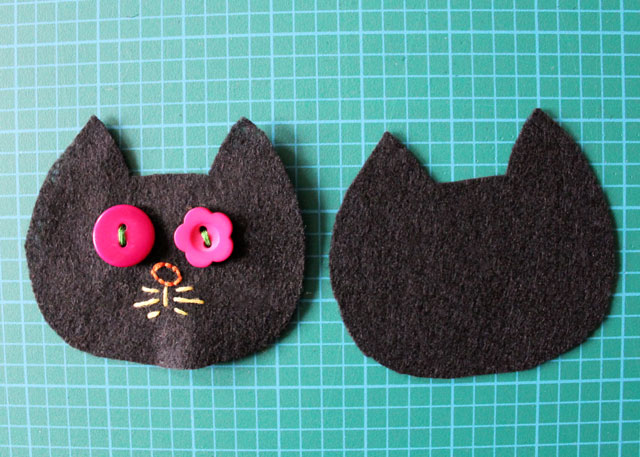 making face on felt cat embroidery and buttons