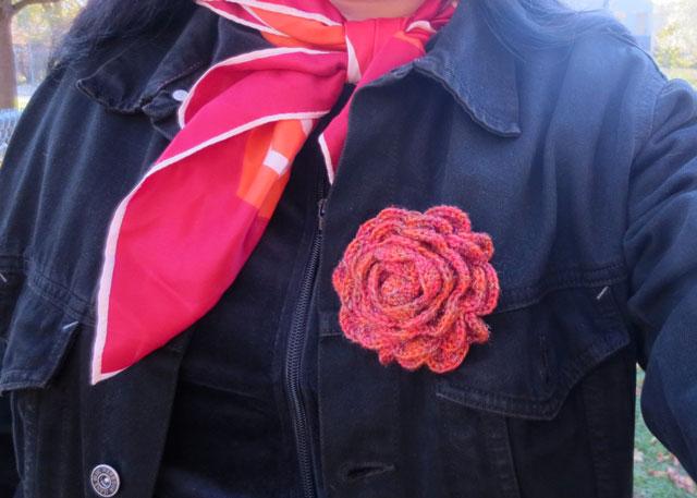 crocheted-rose-brooch-being-worn