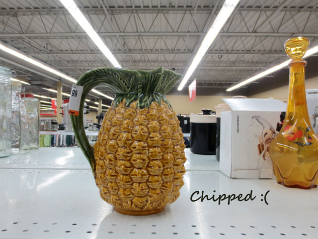 chipped pineapple pitcher at thrift store left behind