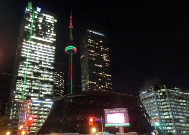 cn tower lit with christmas colours king street west