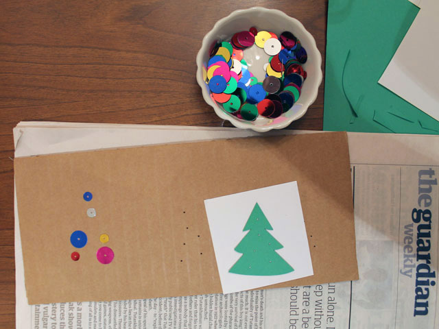 making a gift tag with sequins and beads