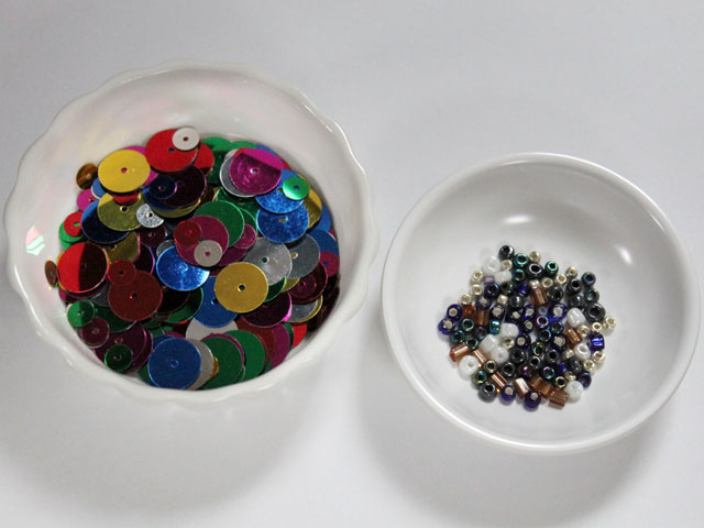 sequins-and-beads-in-small-bowls-to-make-gift-tags