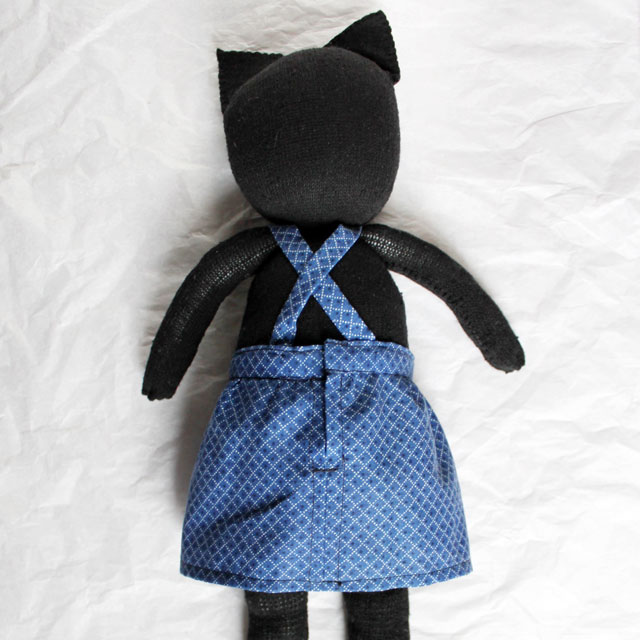 back of bibbed skirt on handmade stuffed cat doll