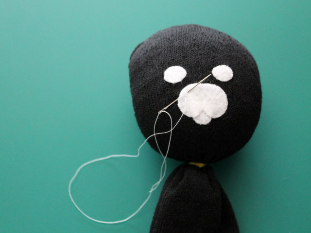 making stuffed doll from a sock face