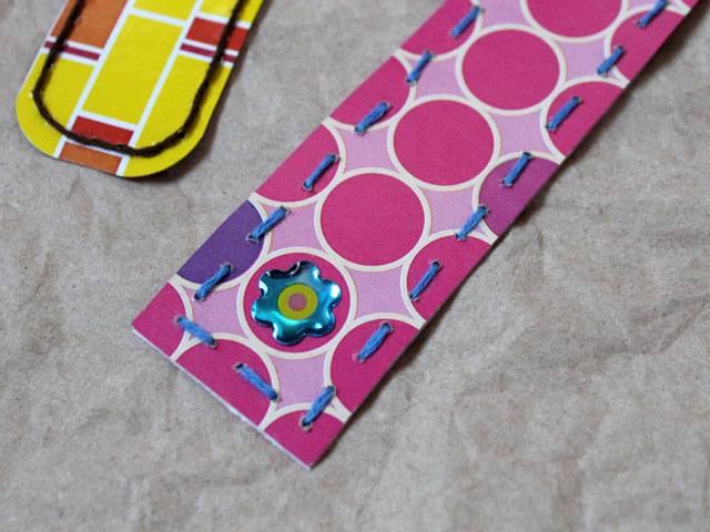 use-a-sticker-on-a-bookmark-made-from-a-repurposed-tissue-box