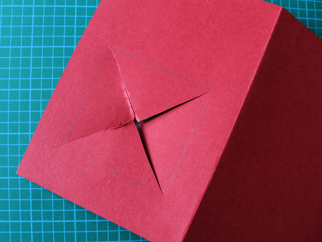 cut a square in the front of the card