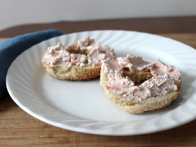 homemade smoked salmon and cream cheese spread with onions and capers on a bagel