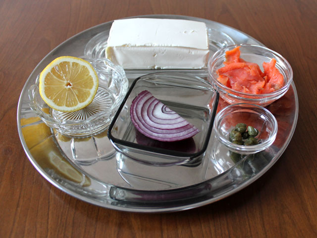 ingredients to make smoked salmon and cream cheese spread with capers onion and lemon juice