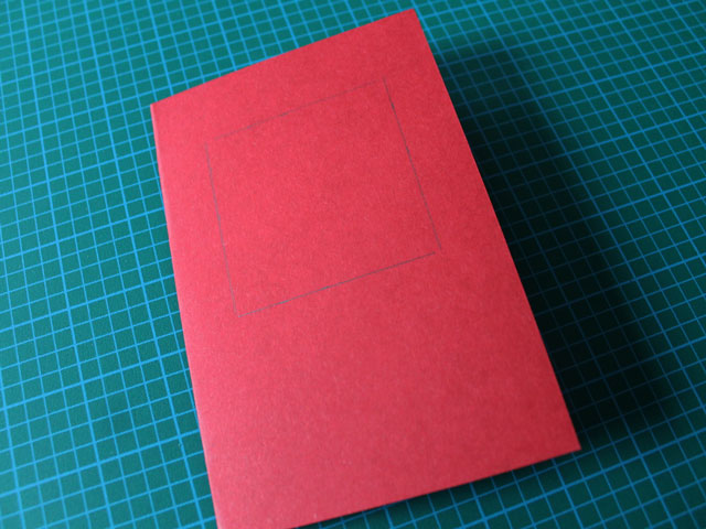 lightly draw a square on the front with a pencil