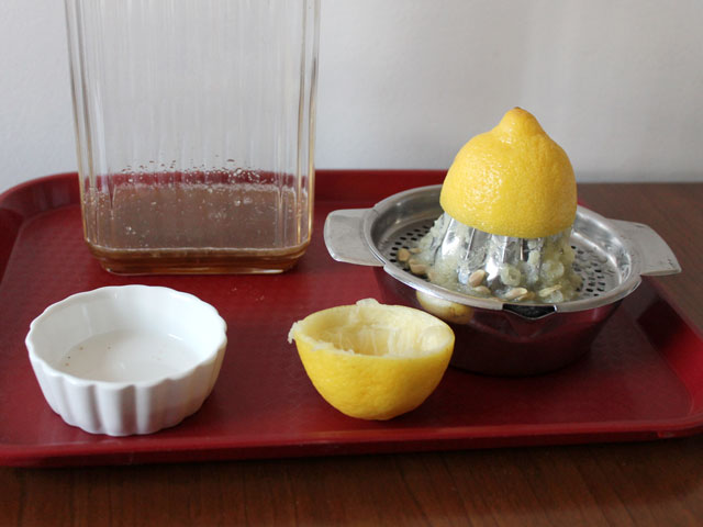 making hot tea cocktail with lemon and brown sugar