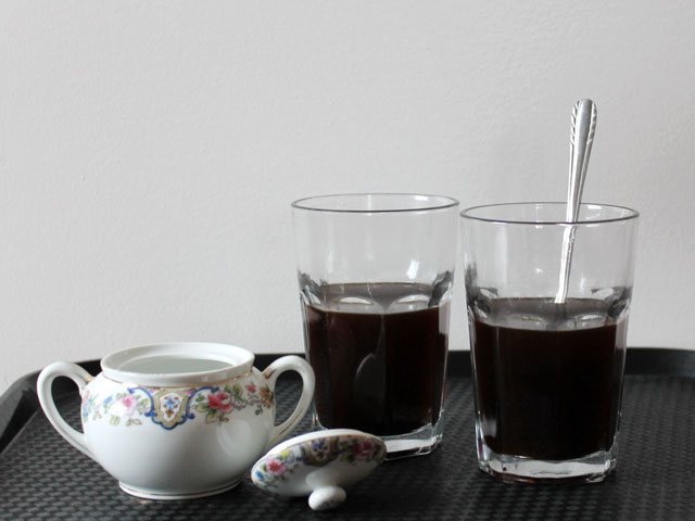 adding-sugar-to-homemade-cardamom-latte