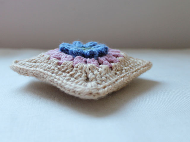 dadas place primavera flower granny square made into a sachet cover sideview