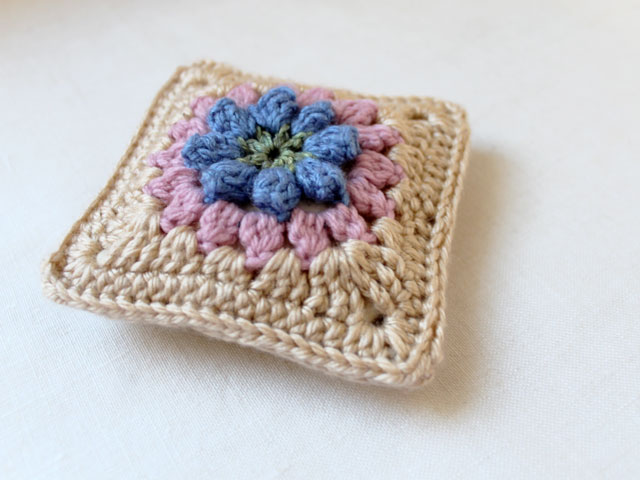 dadas place primavera flower granny square made into a sachet cover