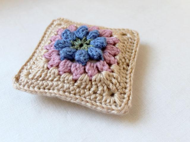 dadas place primavera flower granny square made into a sachet cover