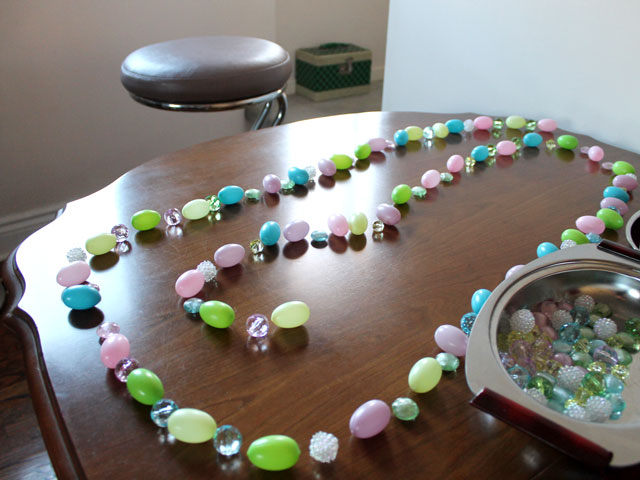 making easter garland lay out eggs and beads first