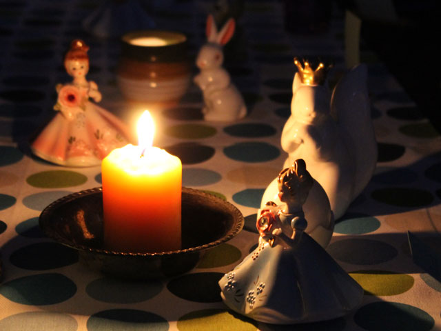 figurines-in-candlelight
