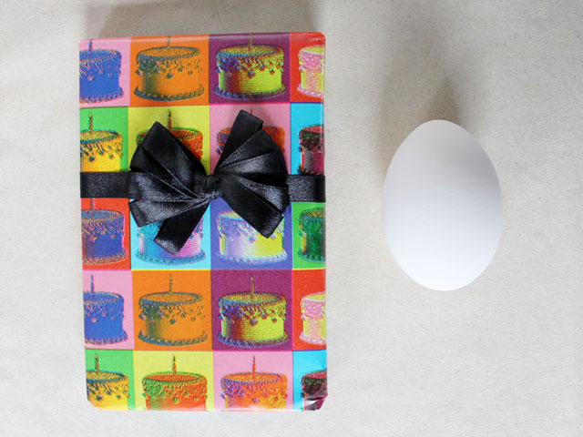 ribbon bow shown with an egg to see size