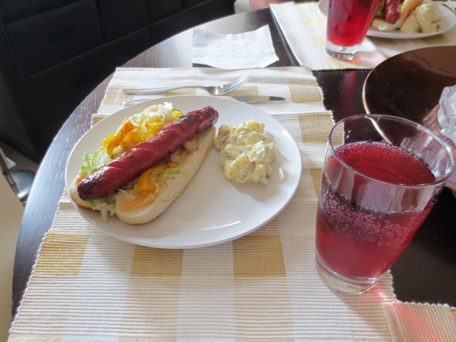 barbecued hot dog and growers pomegranate cider
