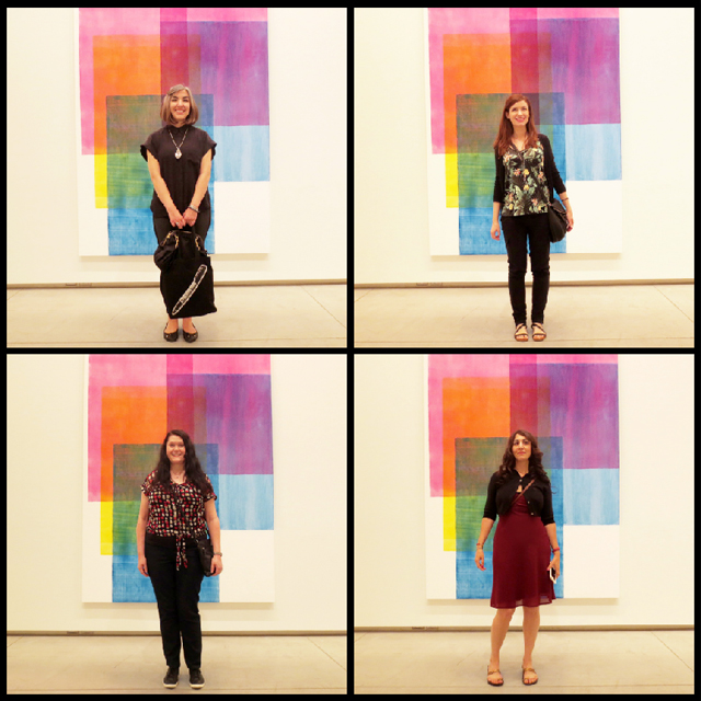 four of us in front of painting