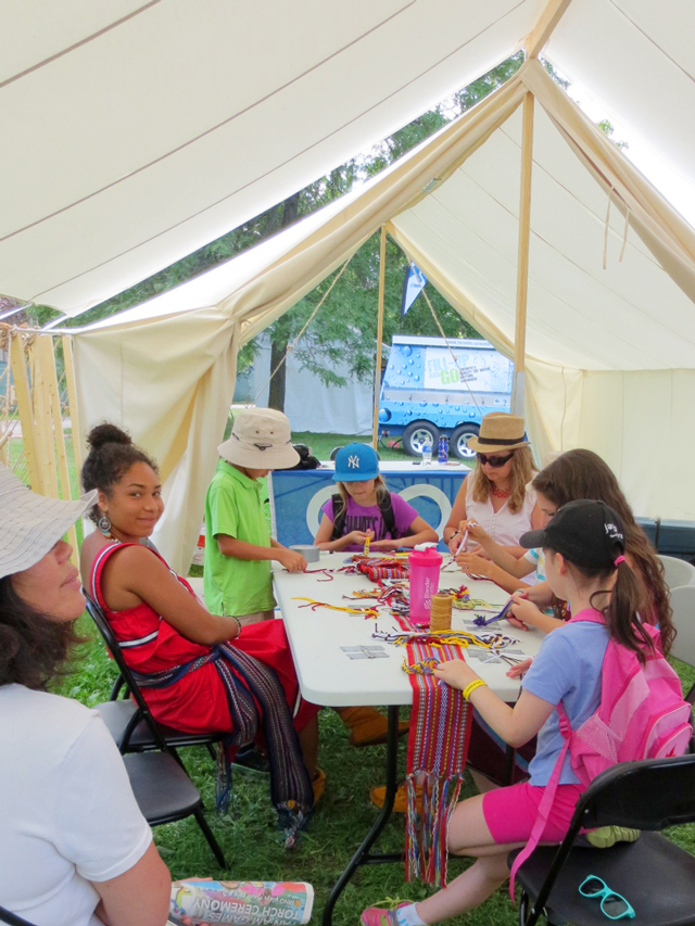 learning how to finger weave at aboriginal pavilion toronto