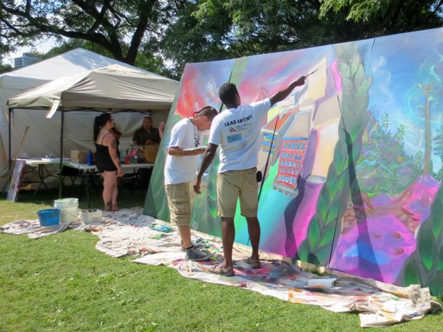 mural being painted onsite at aboriginal pavilion toronto