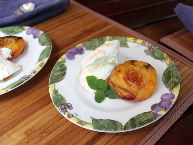 barbecued peaches served with rum and vanilla ice cream