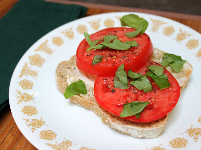 best tomato sandwich open face toast mayonnaise sliced field tomatoes torn basil leaves freshly ground pepper and sea salt