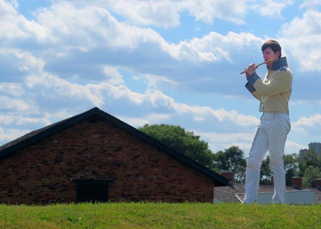 boy playing fife wearing historic uniform fort york toronto